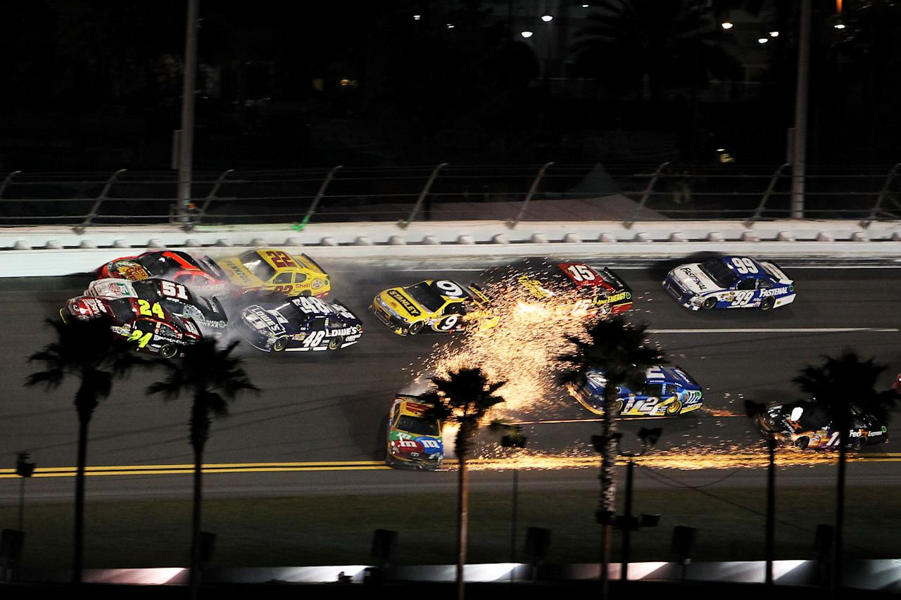 DAYTONA BEACH, FL - FEBRUARY 18: Jeff Gordon, driver of the #24 Drive to End Hunger Chevrolet, Kurt Busch, driver of the #51 Tag Heuer Avant-Garde Chevrolet Chevrolet, Jamie McMurray, driver of the #1 Bass Pro Shops/Tracker Boats Chevrolet, Jimmie Johnson, driver of the #48 Lowe's Chevrolet, and Kyle Busch, driver of the #18 M&M's Brown Toyota, crash in the front of the field during the NASCAR Budweiser Shootout at Daytona International Speedway on February 18, 2012 in Daytona Beach, Florida.  (Photo by Jamie Squire/Getty Images)