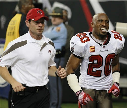 Tampa Bay Buccaneers' Ronde Barber (20) runs off the field after being injured during the second half of an NFL football game against the Atlanta Falcons, Sunday, Jan. 1, 2012, in Atlanta. The Falcons won 45-24. (AP Photo/John Bazemore)