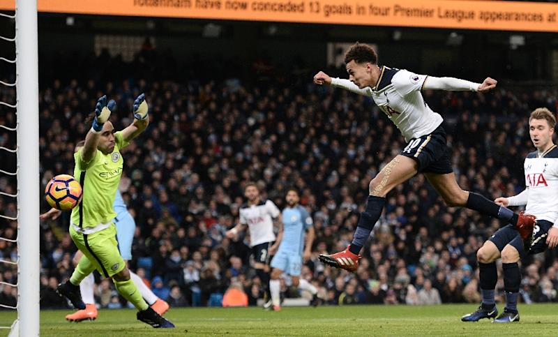 Tottenham Hotspur's midfielder Dele Alli (2nd R) jumps to head their first goal past Manchester City's goalkeeper Claudio Bravo on January 21, 2017