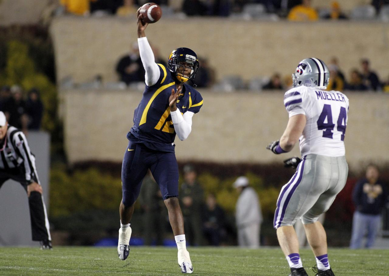 MORGANTOWN, WV - OCTOBER 20:  Geno Smith #12 of the West Virginia Mountaineers drops back to pass against the Kansas State Wildcats during the game on October 20, 2012 at Mountaineer Field in Morgantown, West Virginia.  (Photo by Justin K. Aller/Getty Images)
