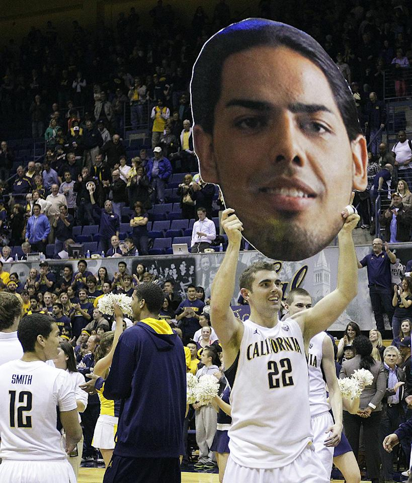 California's Harper Kamp (22) carries a poster image of teammate Jorge Gutierrez after an NCAA college basketball game against Oregon State Saturday, Feb. 18, 2012, in Berkeley, Calif.