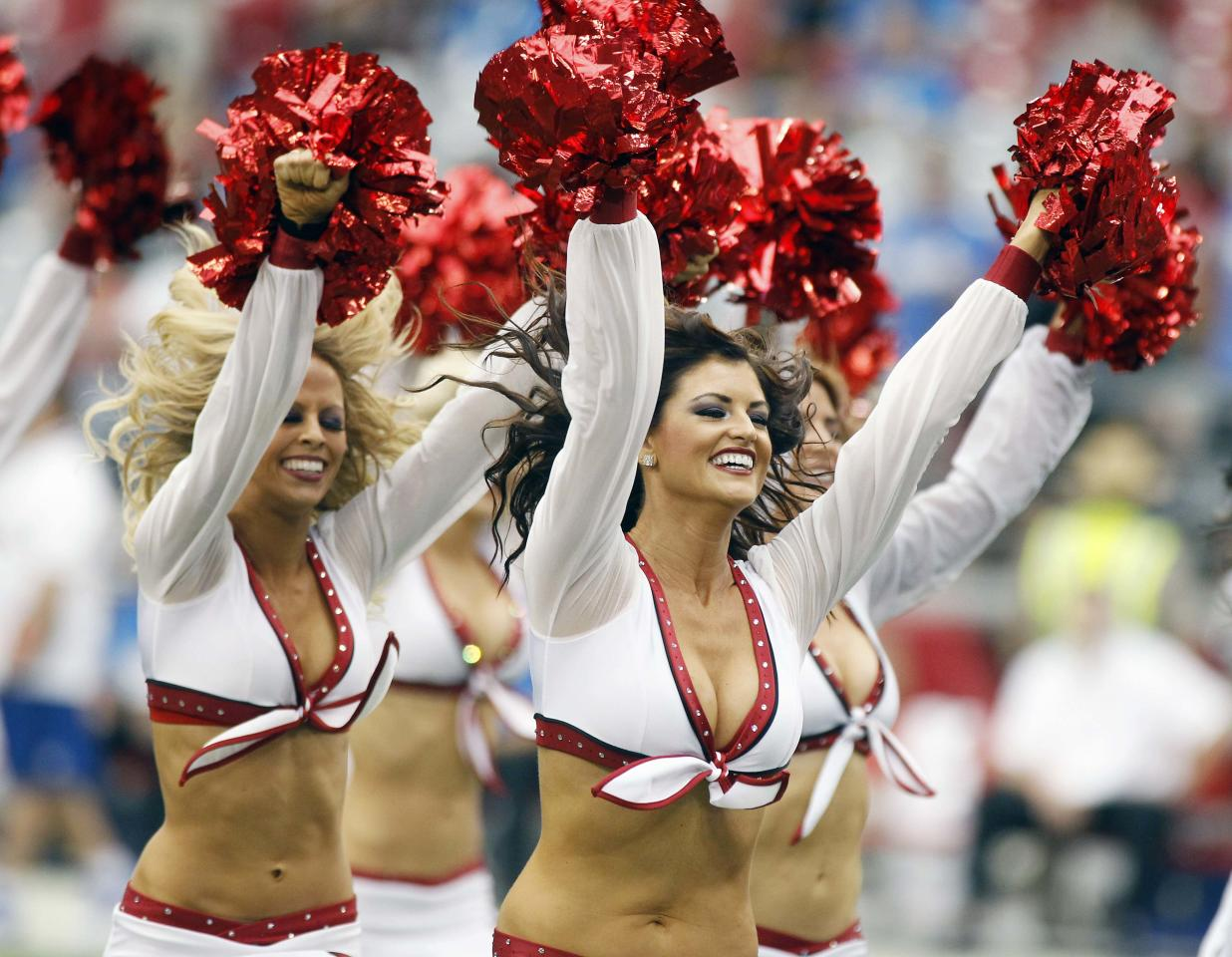 The Arizona Cardinals cheerleaders perform during the first half of their NFL football game against the Detroit Lions in Phoenix, Arizona, September 15, 2013. REUTERS/Ralph D. Freso (UNITED STATES - Tags: SPORT FOOTBALL)