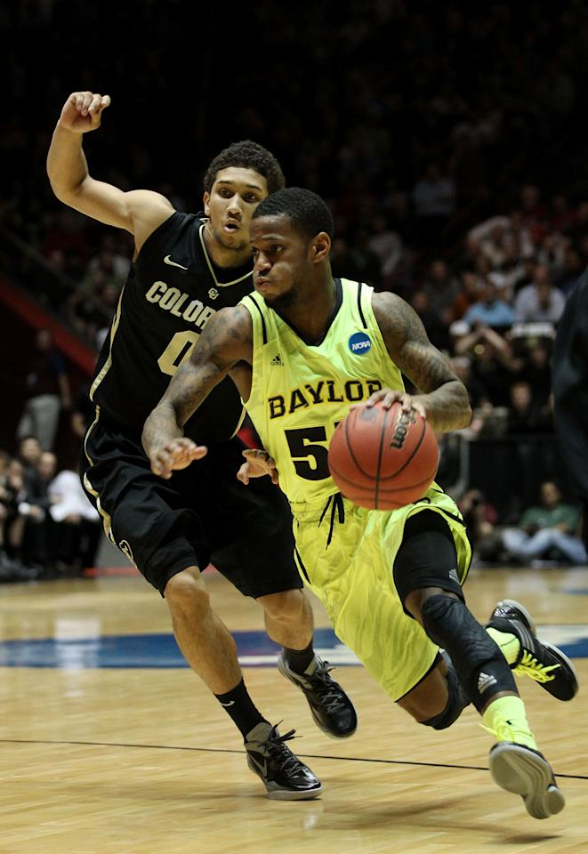 ALBUQUERQUE, NM - MARCH 17: Pierre Jackson #55 of the Baylor Bears drives against Askia Booker #0 of the Colorado Buffaloes in the second half of the game during the third round of the 2012 NCAA Men's Basketball Tournament at The Pit on March 17, 2012 in Albuquerque, New Mexico.  (Photo by Christian Petersen/Getty Images)
