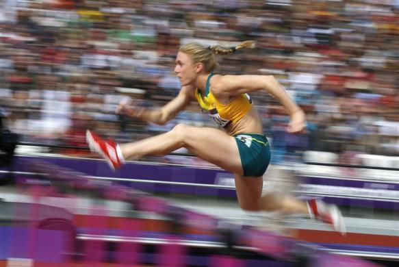 Australia's Sally Pearson competes during her women's 100m hurdles round 1 heat during the London 2012 Olympic Games at the Olympic Stadium August 6, 2012.