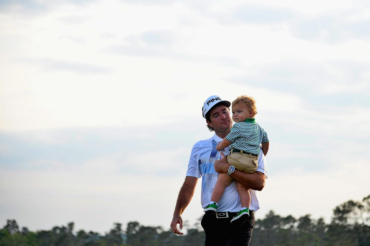 AUGUSTA, GA - APRIL 13: Bubba Watson of the United States walks with his son Caleb off the 18th green after winning the 2014 Masters Tournament by a three-stroke margin at Augusta National Golf Club on April 13, 2014 in Augusta, Georgia. (Photo by Harry How/Getty Images)