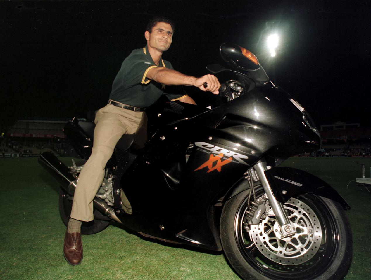 4 Feb 2000: Pakistan player Abdur Razzaq sits on board his new motorcycle which he won after being named Player of the Series for the Carlton and United Breweries one day international series between Pakistan, India and Australia. Australia defeated Pakistan in the second final at the Sydney Cricket Ground, Sydney, Australia to take out the series. Mandatory Credit: Jack Atley/ALLSPORT