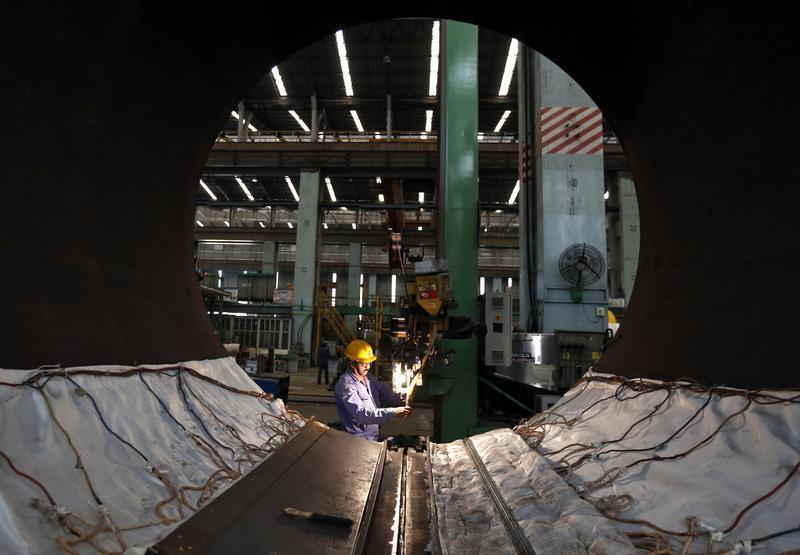 An employee works on the production line inside the heavy electrical manufacturing unit of Larsen & Turbo in Mumbai