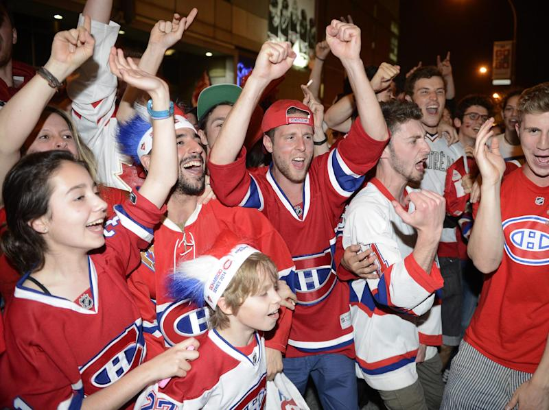 Montreal Canadiens fans in Montreal celebrate after the Canadiens advanced to the NHL hockey Stanley Cup Eastern Conference finals with a 3-1 win over the Boston Bruins in a game in Boston, Wednesday May 14, 2014