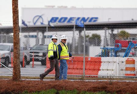 Workers walk through the Boeing South Carolina Plant in North Charleston
