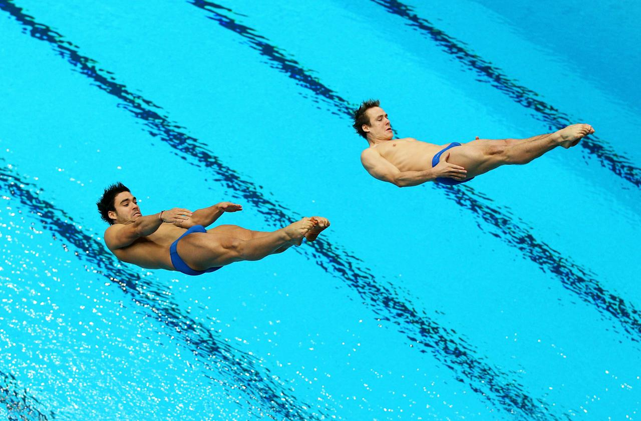 DELHI, INDIA - OCTOBER 12:  Alexandre Despatie and Reuben Ross of Canada compete in the Men's 3m Synchro Springboard Final at Dr. S.P. Mukherjee Aquatics Complex on day nine of the Delhi 2010 Commonwealth Games on October 12, 2010 in Delhi, India.  (Photo by Cameron Spencer/Getty Images)