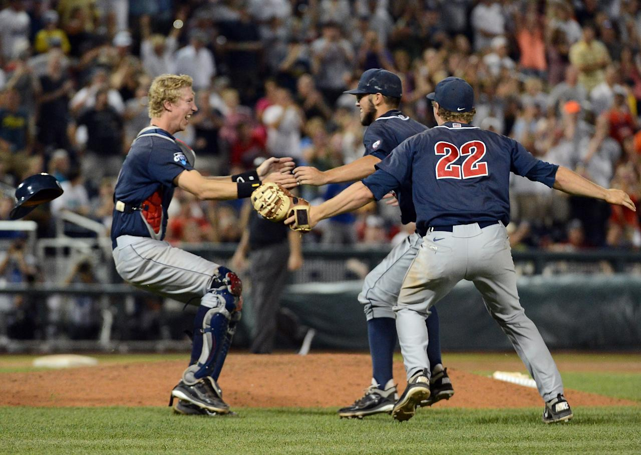 OMAHA, NE - JUNE 25:  Riley Moore #6, Mathew Troup #44 and Brandon Dixon #22 of th Arizona Wildcats celebrate the final out and a 4-1 win over the South Carolina Gamecocks during game 2 of the College World Series at TD Ameritrade Field on June 25, 2012 in Omaha, Nebraska.  (Photo by Harry How/Getty Images)