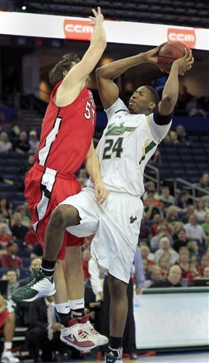 Collins helps South Florida beat Rutgers 67-65