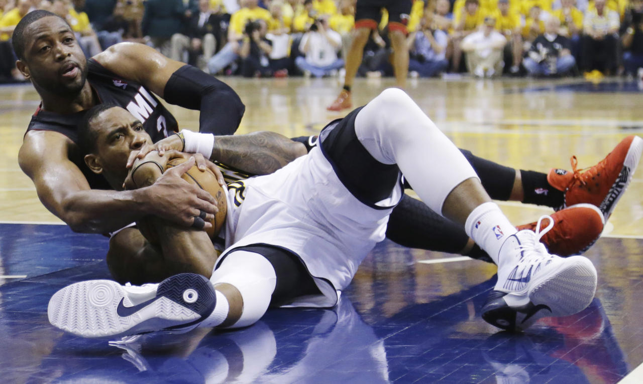 Miami Heat guard Dwyane Wade, left, and Indiana Pacers guard Rasual Butler look for a call from an official during the first half of Game 5 of the NBA basketball Eastern Conference finals in Indianapolis, Wednesday, May 28, 2014. (AP Photo/Michael Conroy)