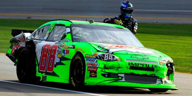 Dale Earnhardt Jr. drives teammate Jimmie Johnson to the garage after their Talladega wreck. (Getty Images)