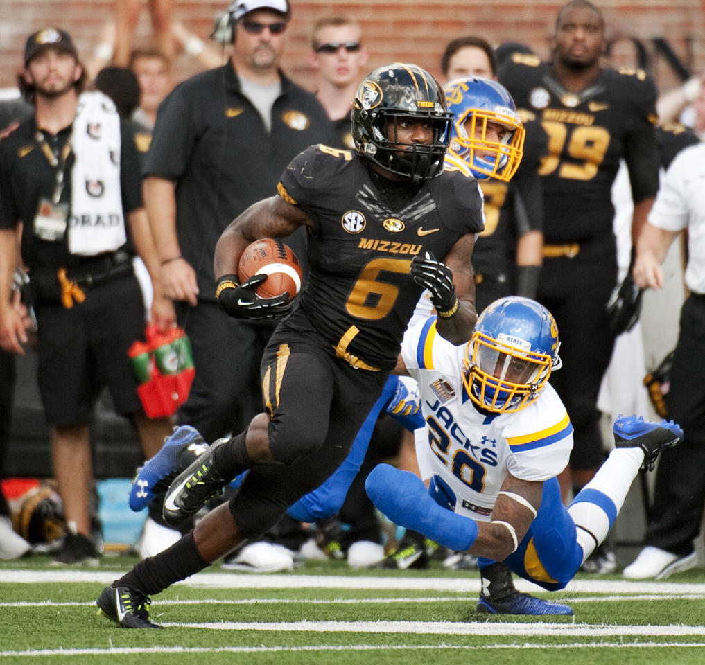 Missouri's Marcus Murphy, left, runs past a diving South Dakota State's Freeman Simmons, right, as he scores on a 102-yard kickoff return during the third quarter of an NCAA college football game Saturday, Aug. 30, 2014, in Columbia, Mo. (AP Photo/L.G. Patterson)