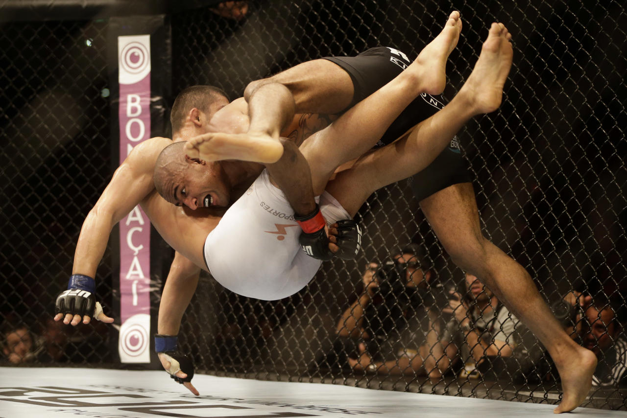 Sergio Moraes, from Brazil, top, fights countryman Renee Forte during their welterweight mixed martial arts bout at the Ultimate Fighting Championship (UFC) 153 in Rio de Janeiro, Brazil, Saturday Oct. 13, 2012. Moraes defeated Forte. (AP Photo/Felipe Dana)