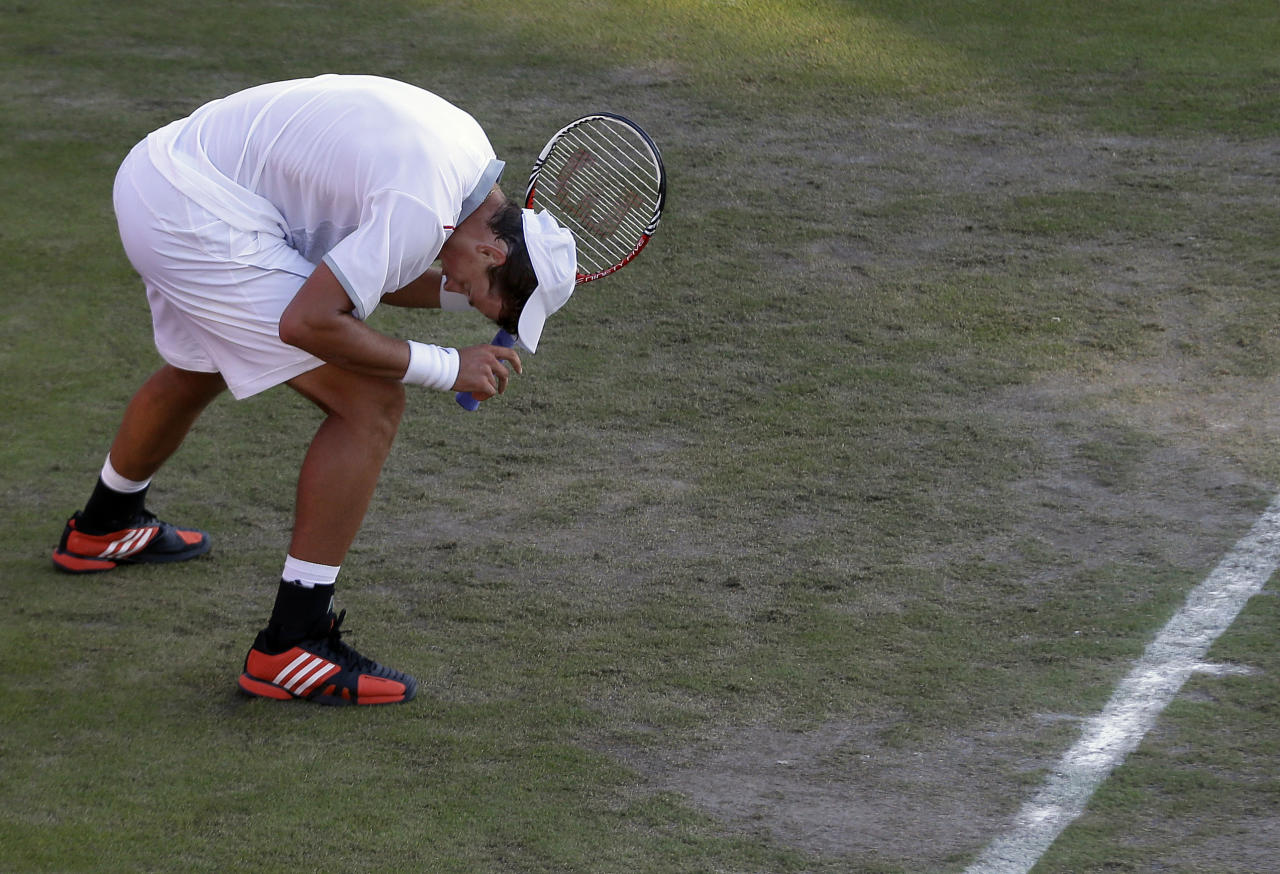 Vasek Pospisil of Canada reacts after losing to David Ferrer of Spain at the All England Lawn Tennis Club in Wimbledon, London at the 2012 Summer Olympics, Sunday, July 29, 2012. (AP Photo/Elise Amendola)