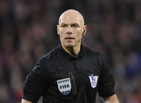 Referee Howard Webb looks on during the English Premier League soccer match between Cardiff City and West Bromwich Albion at Cardiff City Stadium in Cardiff