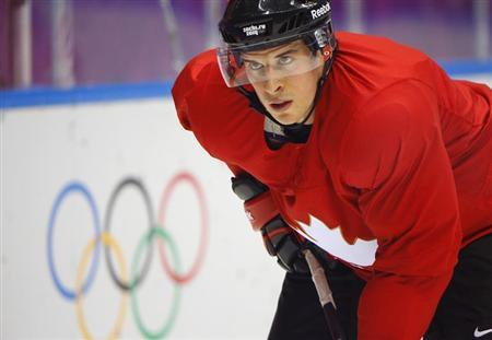 Canada's men's ice hockey player Sidney Crosby attends the team's first practice at the 2014 Sochi Winter Olympics