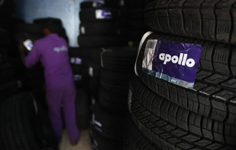 An employee works inside the warehouse at the Apollo Super Zone showroom in Mumbai October 8, 2013.
