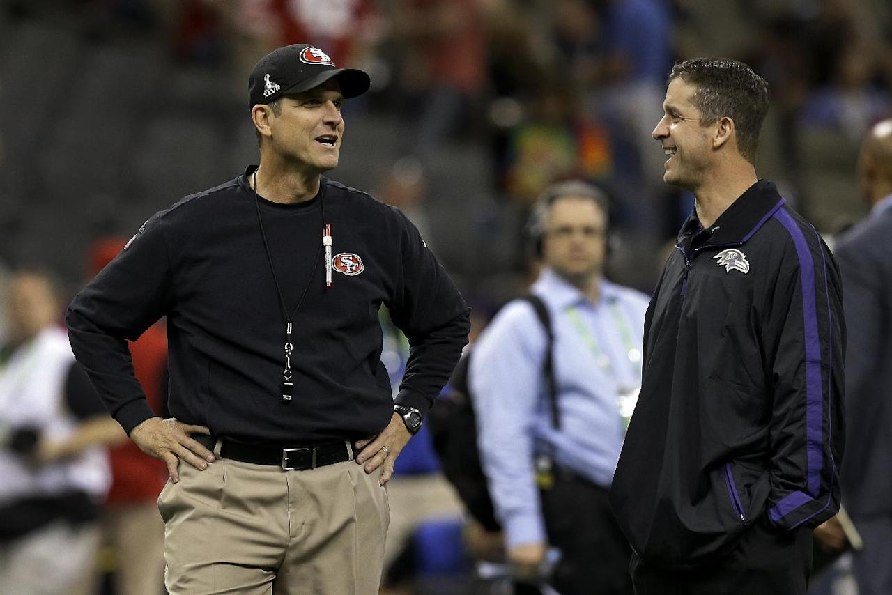 San Francisco 49ers coach Jim Harbaugh, left, talks with Baltimore Ravens coach John Harbaugh before the NFL Super Bowl XLVII football game, Sunday, Feb. 3, 2013, in New Orleans. (AP Photo/Dave Martin)