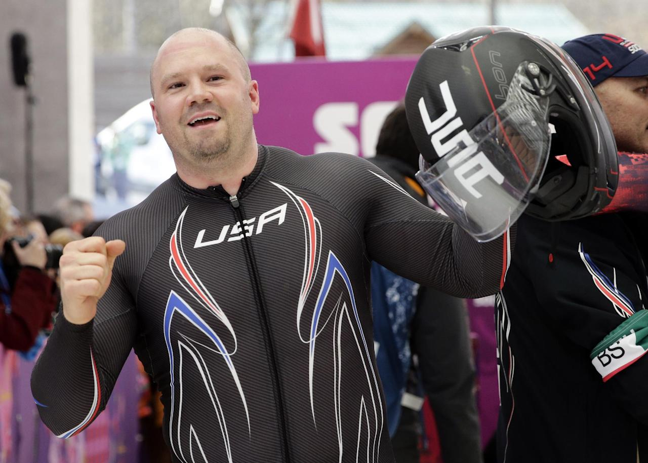 The driver of United States USA-1, Steven Holcomb, acknowledges the crowd after the team won the bronze medal during the men's four-man bobsled competition final at the 2014 Winter Olympics, Sunday, Feb. 23, 2014, in Krasnaya Polyana, Russia. (AP Photo/Jae C. Hong)