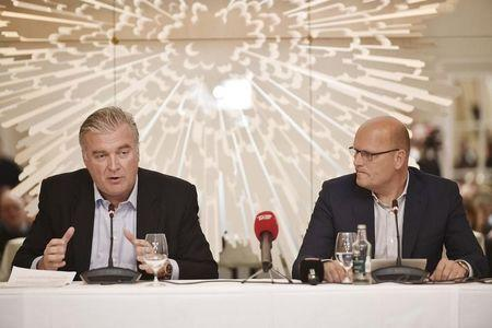 Bjarne Riis, former Team Saxo-Tinkoff boss and Tour de France winner, and former Saxo Bank co-CEO Lars Seier Christensen address a news conference in the Hotel d'Angleterre in Copenhagen, Denmark, February 25, 2016.  REUTERS/Nils Meilvang/Scanpix Denmark
