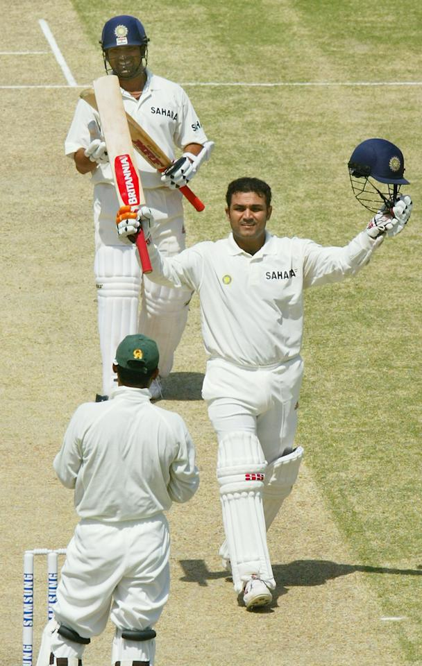 MULTAN, PAKISTAN - MARCH 29:  Virender Sehwag (R) of India celebrates reaching his 300 as teammate Sachin Tendulkar (top) applauds during day 2 of the 1st Test Match between Pakistan and India at Multan Stadium on March 29, 2004 in Multan, Pakistan.  (Photo by Scott Barbour/Getty Images)
