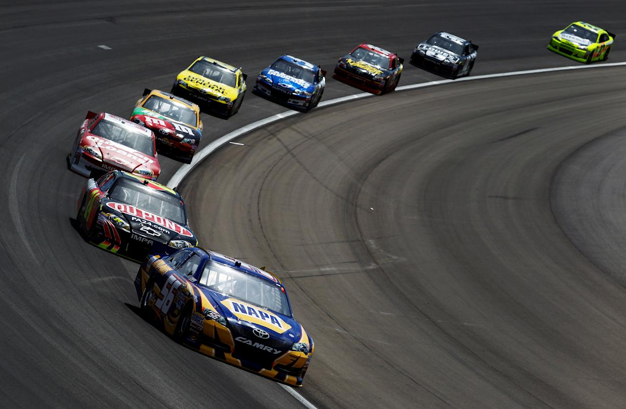 LAS VEGAS, NV - MARCH 11:  Martin Truex Jr., driver of the #56 NAPA Auto Parts Toyota, leads a group of cars during the NASCAR Sprint Cup Series Kobalt Tools 400 at Las Vegas Motor Speedway on March 11, 2012 in Las Vegas, Nevada.  (Photo by Todd Warshaw/Getty Images for NASCAR)