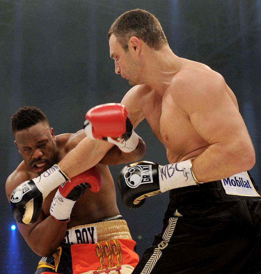 Ukrainian WBC World Champion Vitali Klitschko (R) punches British boxer Dereck Chisora (L) in the WBC World Heavyweight Championship in the Olympic hall in Munich on February 18, 2012.  Klitschko won after 12 rounds.  AFP PHOTO / CHRISTOF STACHE   (Photo credit should read CHRISTOF STACHE/AFP/Getty Images)