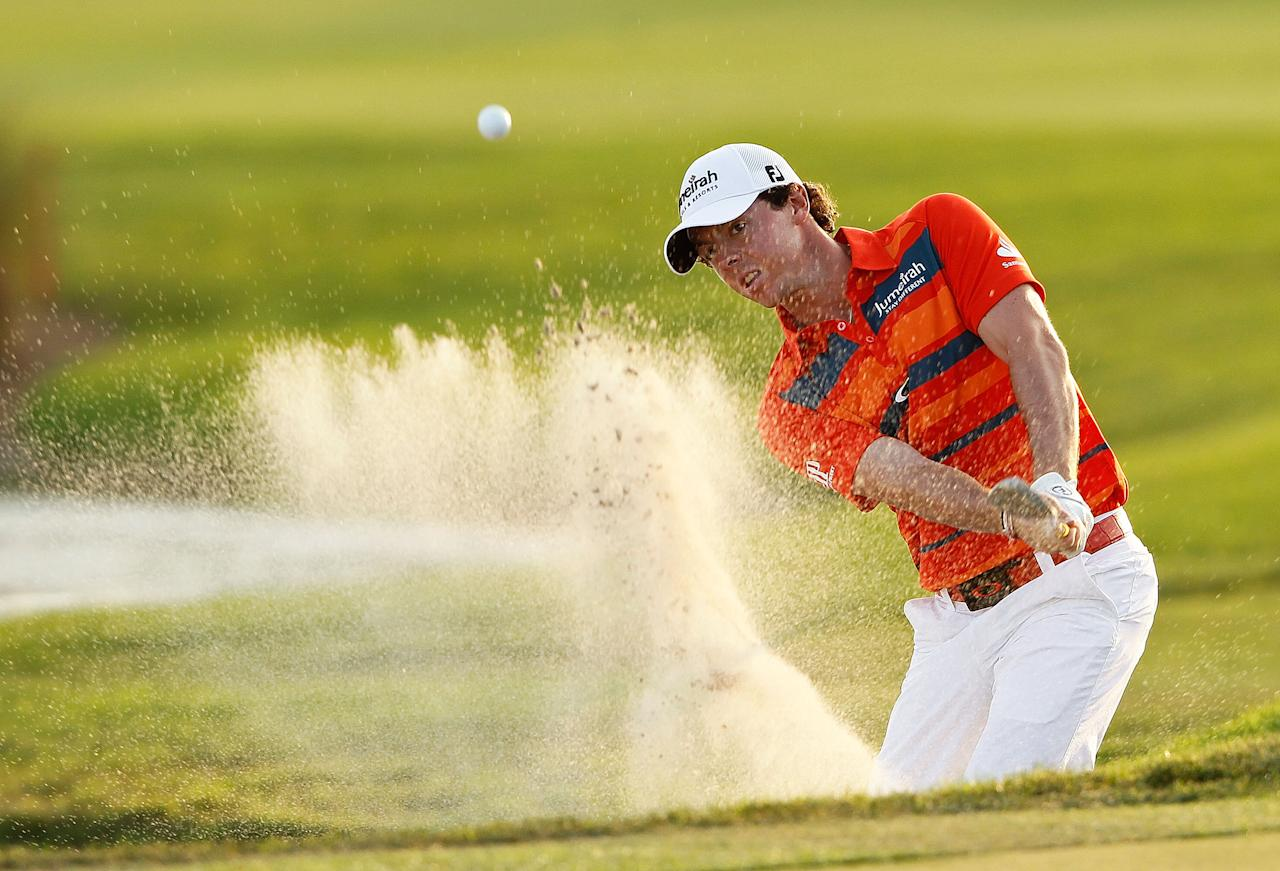 PALM BEACH GARDENS, FL - MARCH 03:  Rory McIlroy of Northern Ireland hits out of the bunker on the 18th hole during the third round of the Honda Classic at PGA National on March 3, 2012 in Palm Beach Gardens, Florida.  (Photo by Mike Ehrmann/Getty Images)