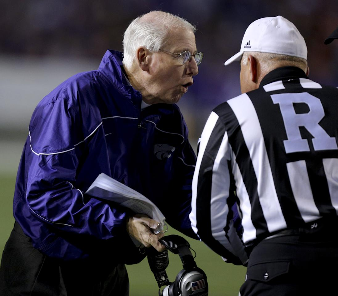 MANHATTAN, KS - NOVEMBER 03: Head coach Bill Snyder of the Kansas State Wildcats talks with an official during a time out during a game against the Oklahoma State Cowboys in the second quarter at Bill Snyder Family Football Stadium on November 3, 2012 in Manhattan, Kansas. (Photo by Ed Zurga/Getty Images)