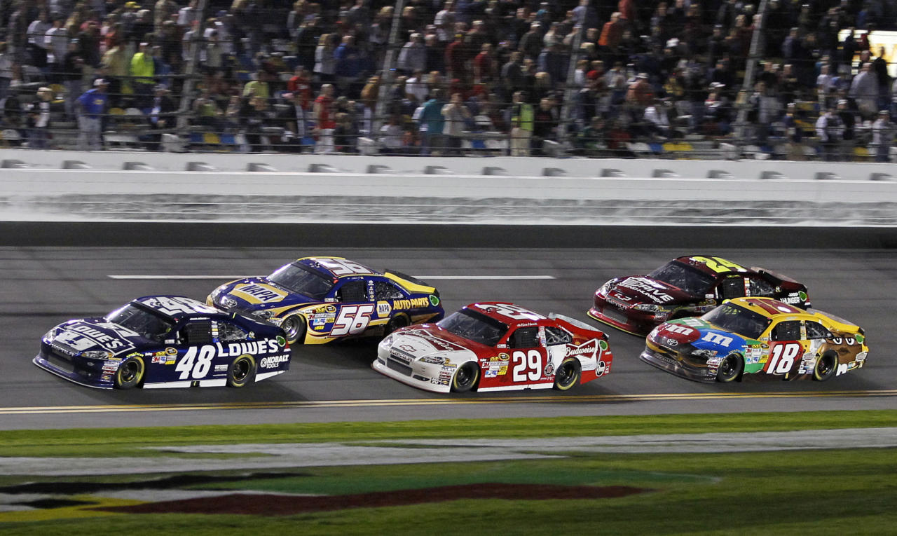 Jimmie Johnson (48) leads Martin Truex Jr. (56), Kevin Harvick (29), Jeff Gordon (24) and Kyle Busch (18) heading to Turn 1 during the NASCAR Budweiser Shootout auto race at Daytona International Speedway, Saturday, Feb. 18, 2012, in Daytona Beach, Fla. (AP Photo/Terry Renna)