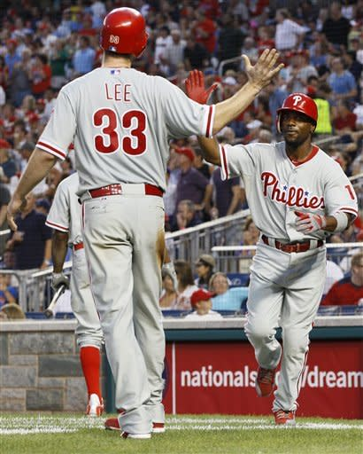 Lee stays with Phillies, beats Nationals 8-0
