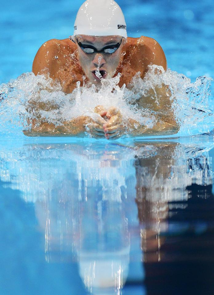 Eric Shanteau swims in the men's 200-meter breaststroke preliminaries at the U.S. Olympic swimming trials, Thursday, June 28, 2012, in Omaha, Neb. (AP Photo/Mark J. Terrill)