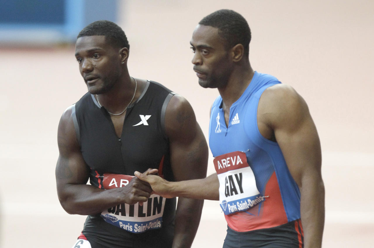 Tyson Gay of USA, right, is congratulated by Justin Gatlin of USA after winning the 100m men's race at the IAF Diamond League athletics meeting at the Stade de France in Saint-Denis, north of Paris, Friday, July 6, 2012. (AP Photo/Lionel Cironneau)