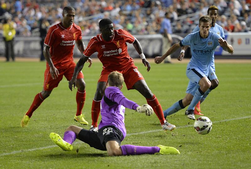 Manchester City's Stevan Jovetic goes past Liverpool's goalkeeper to score during a match in New York on July 30, 2014