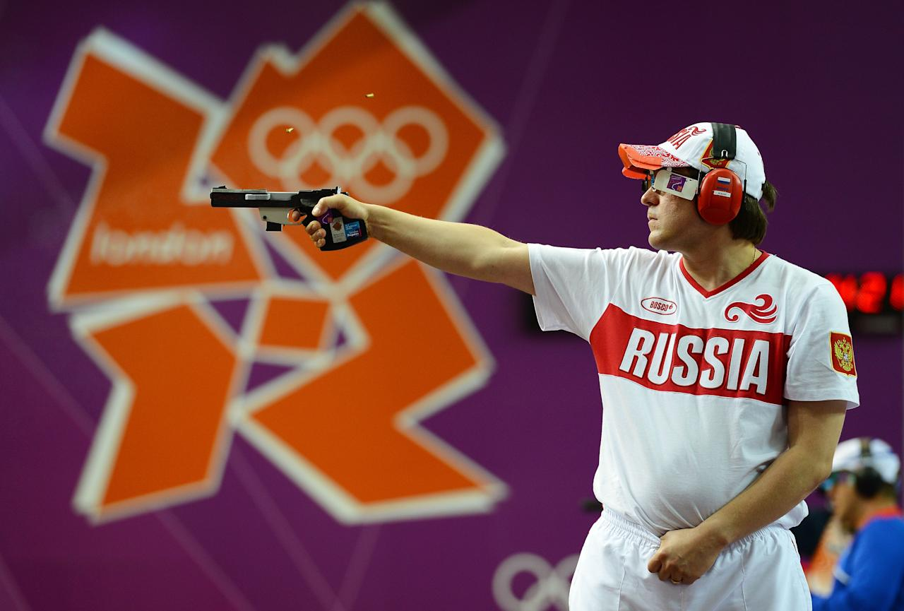 LONDON, ENGLAND - AUGUST 03:  Alexei Klimov of Russia competes in the Men's 25m Rapid Fire Pistol Shooting final on Day 7 of the London 2012 Olympic Games at The Royal Artillery Barracks on August 3, 2012 in London, England.  (Photo by Lars Baron/Getty Images)