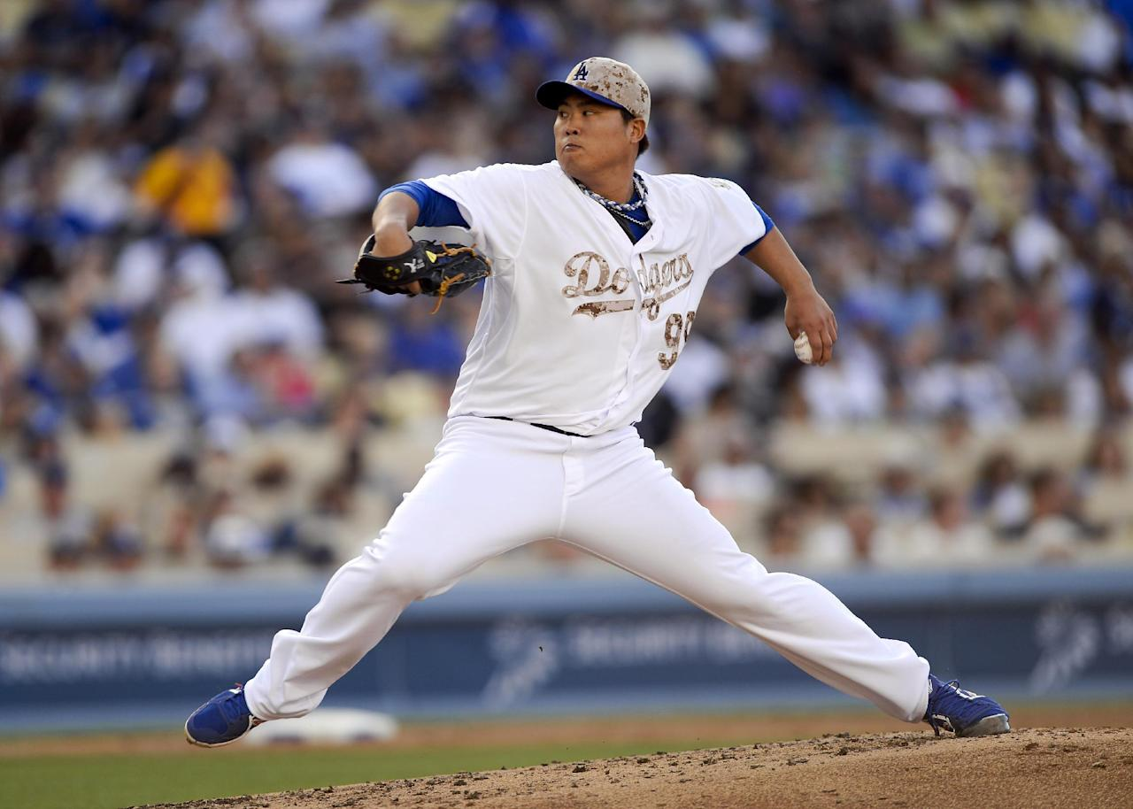 Los Angeles Dodgers starting pitcher Hyun-Jin Ryu throws in the fourth inning of a baseball game against the Cincinnati Reds, Monday, May 26, 2014, in Los Angeles. (AP Photo/Gus Ruelas)