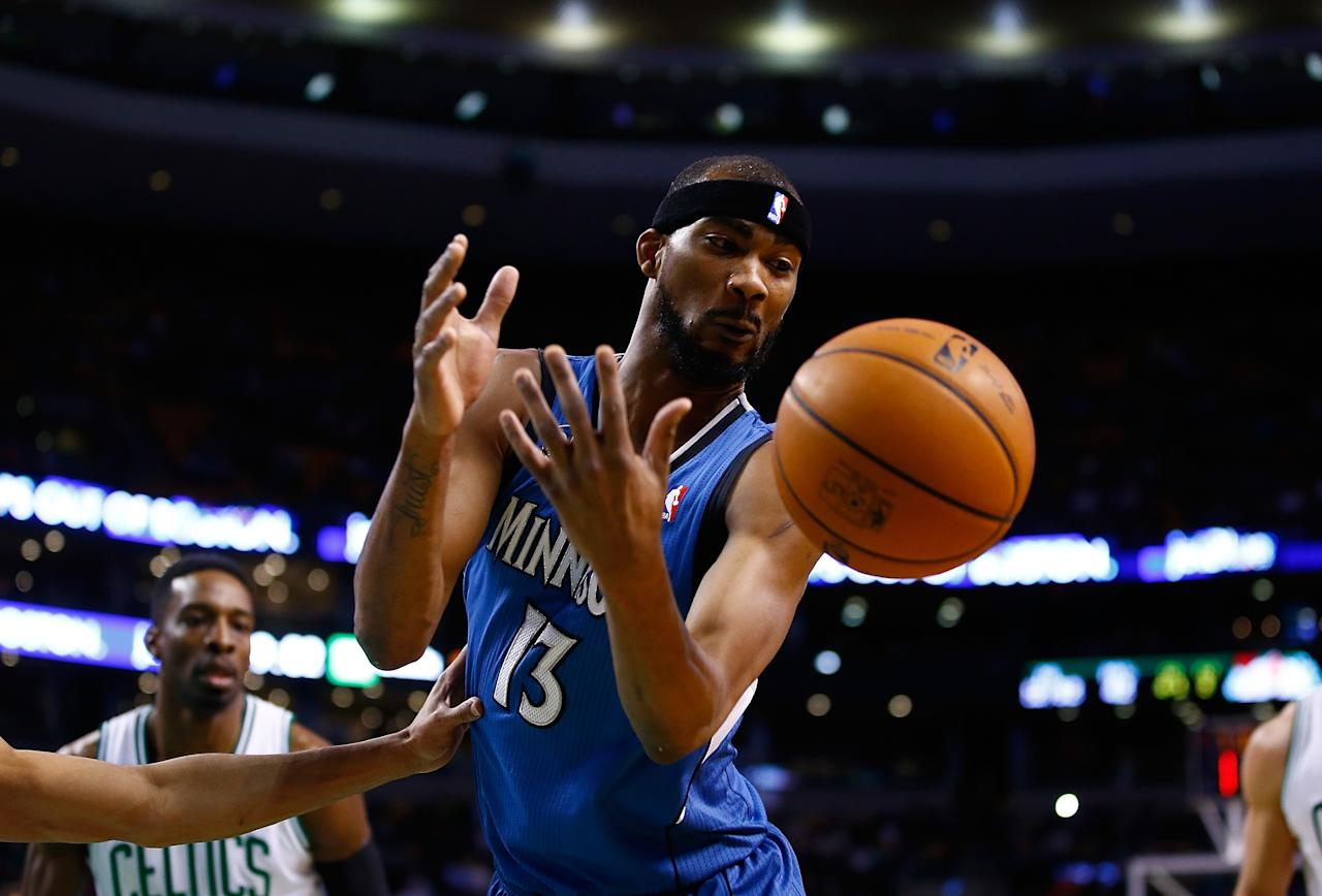BOSTON, MA - DECEMBER 16: Corey Brewer #13 of the Minnesota Timberwolves attempts to grab a loose ball in the second half against the Boston Celtics during the game at TD Garden on December 16, 2013 in Boston, Massachusetts. NOTE TO USER: User expressly acknowledges and agrees that, by downloading and or using this photograph, User is consenting to the terms and conditions of the Getty Images License Agreement. (Photo by Jared Wickerham/Getty Images)