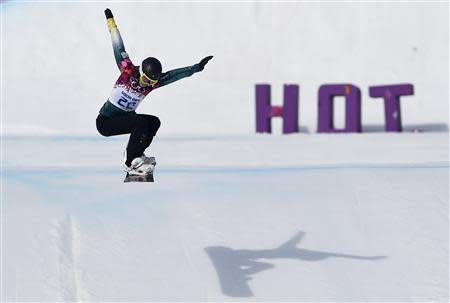 Australia's Bright performs a jump during the women's snowboard cross qualification round at the 2014 Sochi Winter Olympic Games in Rosa Khutor