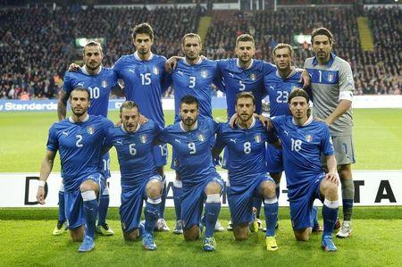 Italy's national soccer players line-up for a team photo before their World Cup Group B qualifying match against Denmark in Copenhagen