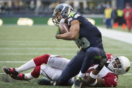 seattles lockett needed lengthy surgery on broken leg
