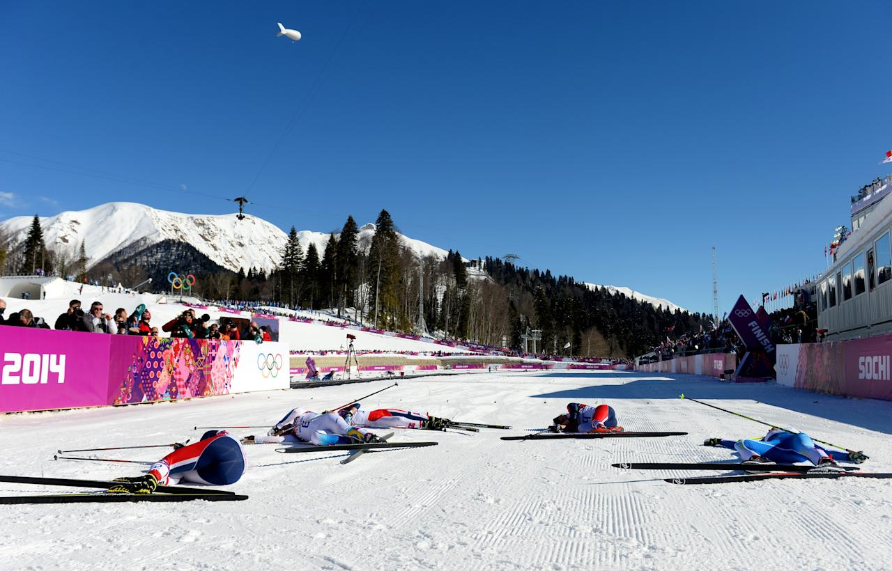 SOCHI, RUSSIA - FEBRUARY 08: Competitors lie in the snow next to the finish line after competing in the Ladies' Skiathlon 7.5 km Classic + 7.5 km Free during day one of the Sochi 2014 Winter Olympics at Laura Cross-country Ski & Biathlon Center on February 8, 2014 in Sochi, Russia. (Photo by Harry How/Getty Images)