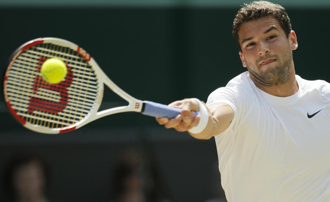 Grigor Dimitrov of Bulgaria reaches to play a return to Andy Murray of Britain during their men's singles quarterfinal match at the All England Lawn Tennis Championships in Wimbledon, London, Wednesday, July 2, 2014. (AP Photo/Pavel Golovkin)