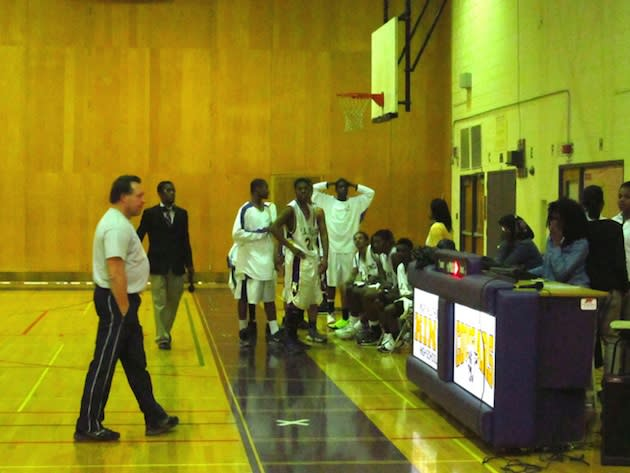 MLK Charter's basketball team awaits a referee decision — Flickr