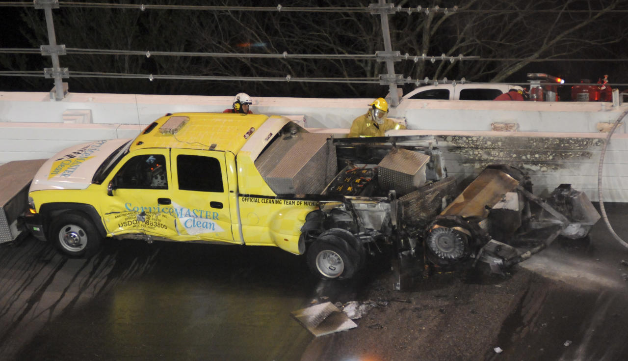 A jet dryer sits on the track after a fire burned the back of the truck during the NASCAR Daytona 500 auto race at Daytona International Speedway in Daytona Beach, Fla., Monday, Feb. 27, 2012. (AP Photo/Zack Hughes)