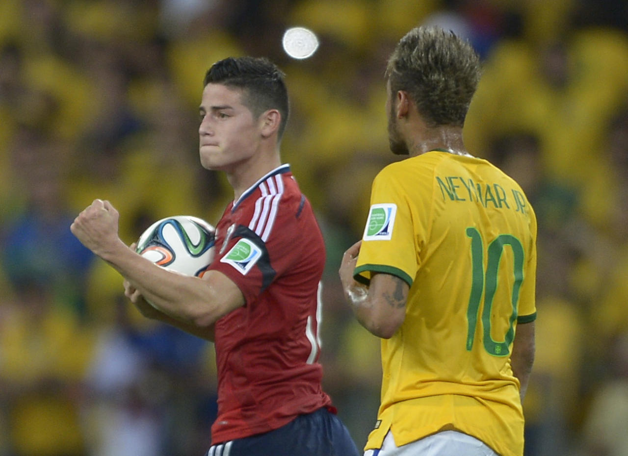 Colombia's James Rodriguez reacts after scoring his side's first goal during the World Cup quarterfinal soccer match between Brazil and Colombia at the Arena Castelao in Fortaleza, Brazil, Friday, July 4, 2014. (AP Photo/Manu Fernandez)