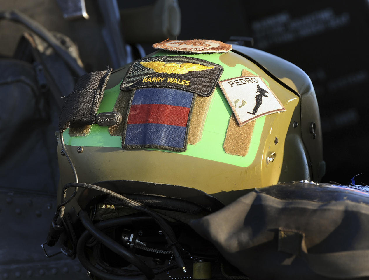 The crash helmet of Prince Harry is seen at the side of the cockpit of his Apache helicopter in Camp Bastion, southern Afghanistan in this photograph taken November 1, 2012. REUTERS/John Stillwell/Pool