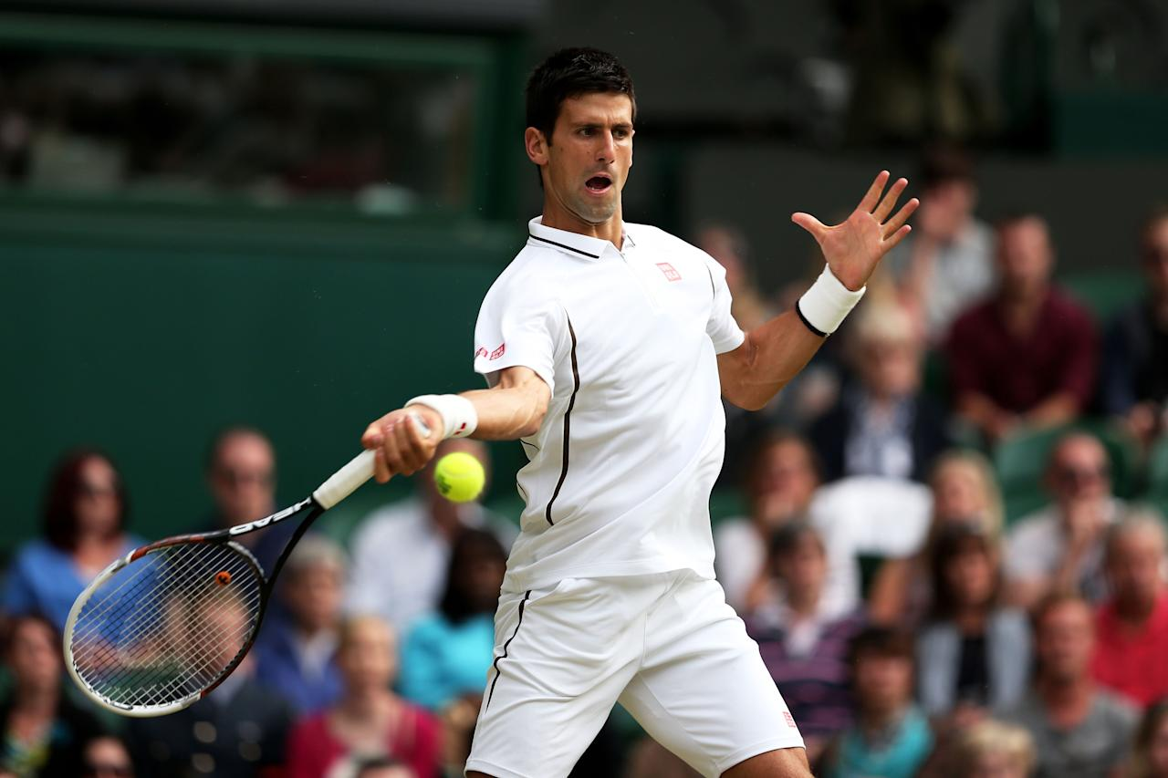 LONDON, ENGLAND - JUNE 29: Novak Djokovic of Serbia plays a forehand during the Gentlemen's Singles third round match against Jeremy Chardy of France on day six of the Wimbledon Lawn Tennis Championships at the All England Lawn Tennis and Croquet Club on June 29, 2013 in London, England. (Photo by Clive Brunskill/Getty Images)